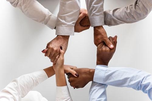 multicultural hands being held