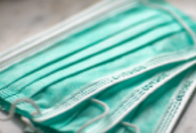 Stack of three blue surgical medical mask