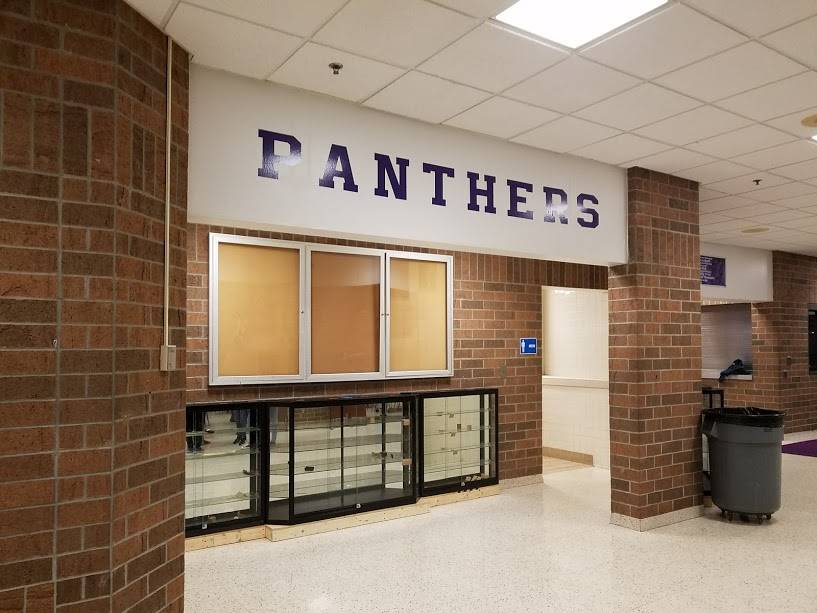 "Students added ""PANTHERS"" on the wall in the main hallway to boost school pride."
