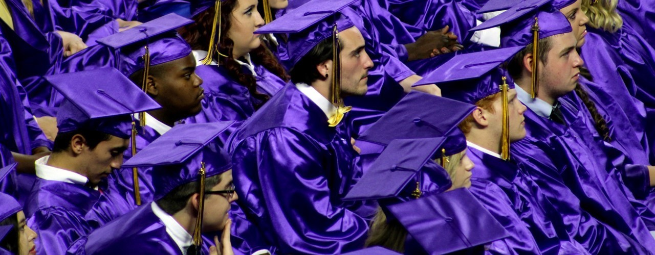 purple cap and gown